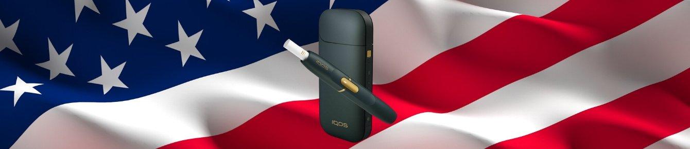 IQOS на фоне американского флага